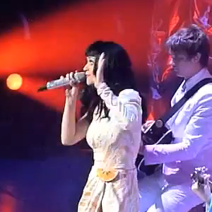 "Katy Perry performing Rebecca Black's song ""Friday"""